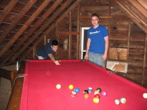 Peter and I playing pool in our attic